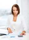 Businesswoman working with calculator in office business concept Royalty Free Stock Photos