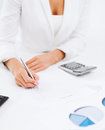 Businesswoman working with calculator in office business tax accounting concept Stock Images