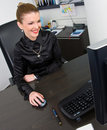 Businesswoman working at desk computer Royalty Free Stock Photography