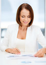 Businesswoman working with graphs in office business concept Stock Images
