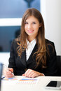 Businesswoman working in her office Royalty Free Stock Photo