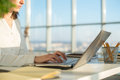 Businesswoman working at home using laptop, studying business Royalty Free Stock Photo