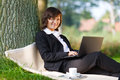 Businesswoman working outdoor in park Stock Photography