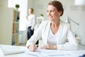 Businesswoman at workplace image of happy sitting Royalty Free Stock Images
