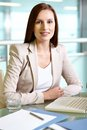 Businesswoman at workplace portrait of confident employee sitting Stock Photos