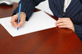Businesswoman write with pen on blank paper Royalty Free Stock Photos