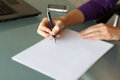 Businesswoman write with pen on blank paper in office Stock Photos