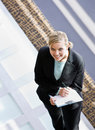 Businesswoman writing on clipboard in office Royalty Free Stock Photo