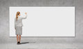 Businesswoman writing with marker on white board Royalty Free Stock Photo