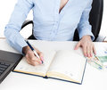 Businesswoman writing in organizer daily planner book Royalty Free Stock Photography