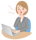 Businesswoman yawning, working at her desk