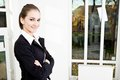 Businesswoman young attractive in office Royalty Free Stock Photos