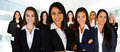 Businesswomen of all races working together in an office Royalty Free Stock Photos