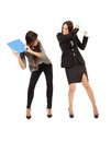 Businesswomen beating each other portrait of with notebooks isolated on white Stock Images