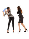 Businesswomen beating each other portrait of with notebooks isolated on white Stock Photography