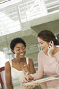 Businesswomen In Conference Meeting One Using Mobile Phone Royalty Free Stock Photo