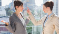Businesswomen fighting in the office Stock Image