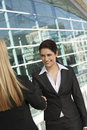 Businesswomen Greeting Each Other Royalty Free Stock Photos