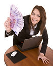 Businesswomen with group of money and laptop. Royalty Free Stock Photo