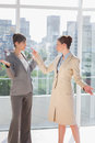 Businesswomen having a fight in bright office Royalty Free Stock Images