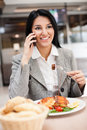 Businesswomen on lunch busy with phone Royalty Free Stock Image