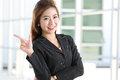 Businesswomen point and invite customer come to his business in the office Royalty Free Stock Photography