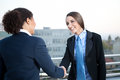 Businesswomen shaking hands Stock Photography