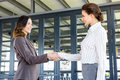 Businesswomen shaking hands with her colleague in office Stock Photos