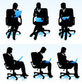 Businesswomen silhouettes of in office chairs Stock Photos