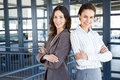 Businesswomen standing with her colleague portrait of in office Royalty Free Stock Images