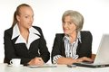 Businnes talk in office young manager and her elderly collegue have a Royalty Free Stock Images