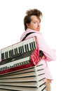 Busker carries on his shoulder accordion Stock Photo
