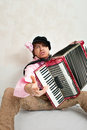 Busker crazy musician plays the accordion Stock Images