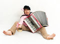 Busker crazy musician plays the accordion Stock Photography
