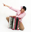 Busker crazy musician sits with accordion Royalty Free Stock Photo