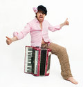 Busker funny musician sits with accordion Royalty Free Stock Image