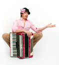 Busker funny musician sits with accordion Stock Images