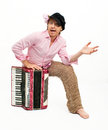 Busker funny musician sits with accordion Royalty Free Stock Photo