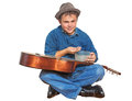 Busker playing guitar isolated young counts earned money and smiling Royalty Free Stock Photos