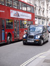 Bussen london taxar Royaltyfria Bilder