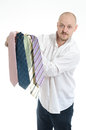 Bussines man hopeless choosing many ties Stock Image