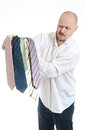 Bussines man hopeless choosing many ties Royalty Free Stock Image