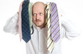 Bussines man hopeless choosing many ties Royalty Free Stock Images
