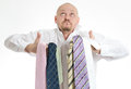 Bussines man hopeless choosing many ties Stock Photography