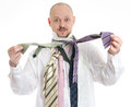 Bussines man hopeless choosing many ties Royalty Free Stock Photo
