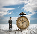 Bussinesman and Alarm clock Royalty Free Stock Photo