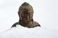 Bust buddha covered snow Royalty Free Stock Photography