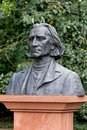 Bust of franz liszt close up the hungarian composer and piano virtuoso ferenc in the old royal baths park warsaw poland Stock Images