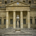 Bust in front of building and clock from religioni et bonis artibus lecce italy Royalty Free Stock Photography