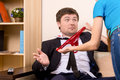 Busted man in formal wear gesturing while his girlfriend showing red panties to him Royalty Free Stock Photography